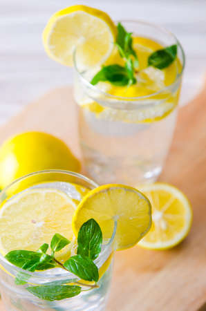 Glasss of mojito with lemon and mint leaves Stock Photo