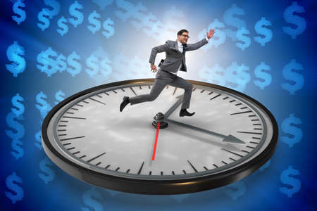Businessman in time management concept Banque d'images