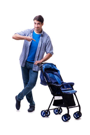 Young dad with baby pram isolated on white background Фото со стока