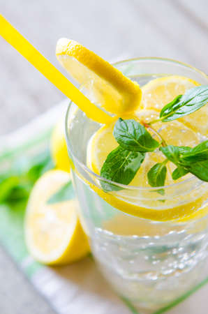 Glasss of mojito with lemon and drinking straw 스톡 콘텐츠