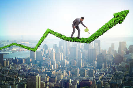 Businessman in investment concept watering financial line chart Imagens - 95296392