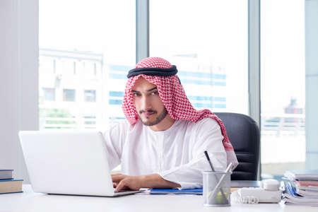 Arab businessman working in the office Фото со стока