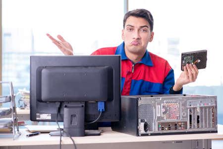 Data restoration specialist repairing corrupt hard drive