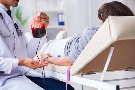 Patient getting blood transfusion in hospital clinic Imagens - 95438643