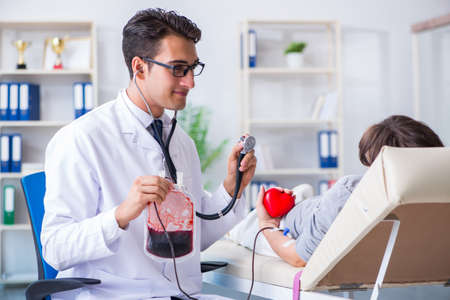 Patient getting blood transfusion in hospital clinic
