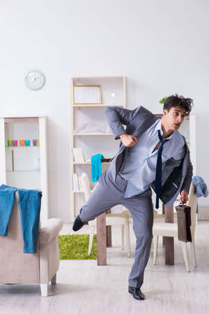 Businessman late for office due to oversleeping after overnight working Stock fotó
