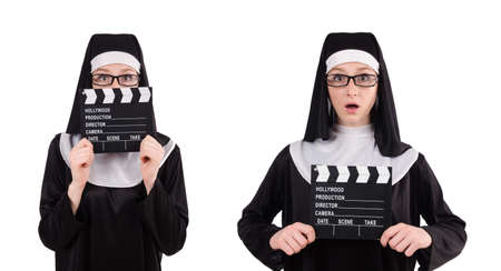 Nun with movie board isolated on white Stok Fotoğraf