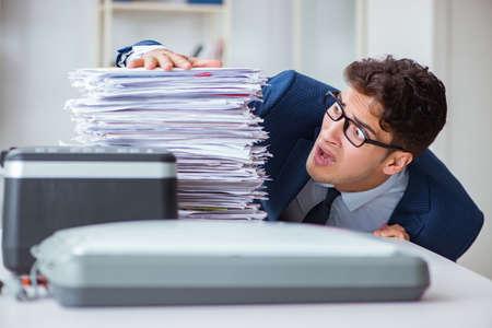 Businessman making copies in copying machine Stok Fotoğraf
