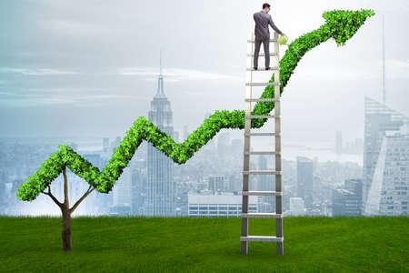 Uomo d'affari nel concetto di investimento che innaffia grafico lineare finanziario