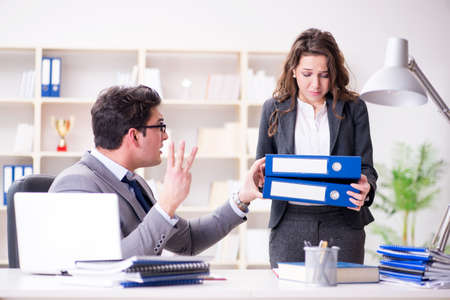 Angry boss unhappy with female employee performance Stock Photo - 96370404