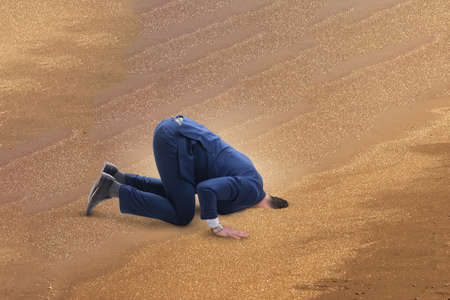 Businessman hiding his head in sand escaping from problems Stok Fotoğraf