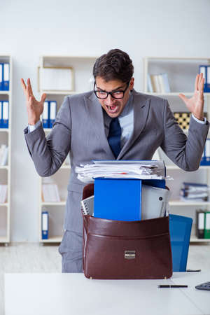Employee with too much work taking it home Stock Photo