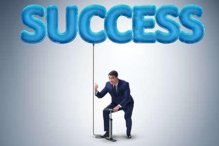Businessman pumping his success with air balloon