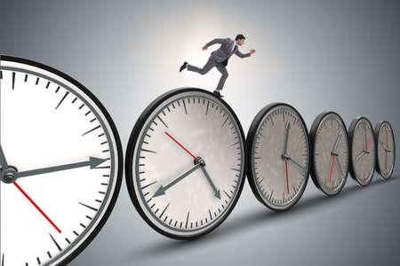 Businessman in time management concept Banque d'images