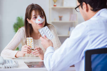 Male doctor talking to patient with nose operation surgery Stock Photo