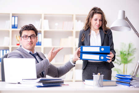 Angry boss unhappy with female employee performance Stock Photo - 96591565