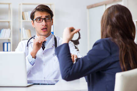 Doctor in corruption concept with being offered bribe Stock Photo