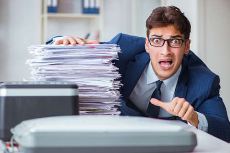 Businessman making copies in copying machine Stock Photo