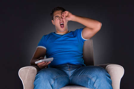 Man watching sports on gray background