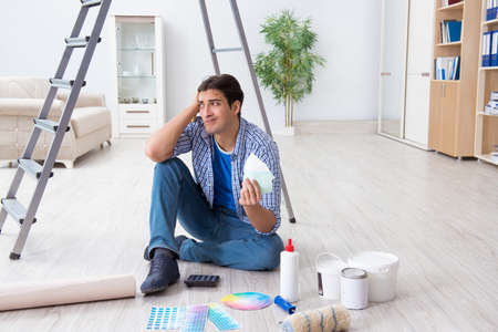 Young man overspending his budget in refurbishment project Фото со стока