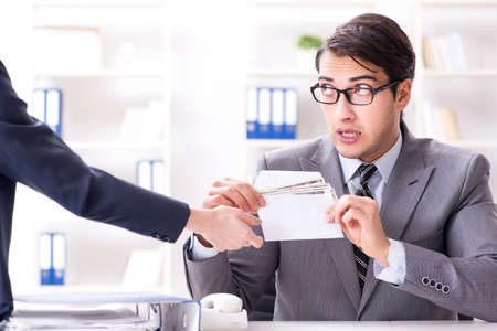 Businessman being offered bribe for breaking law Stock Photo