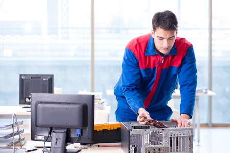 Computer repairman specialist repairing computer desktop