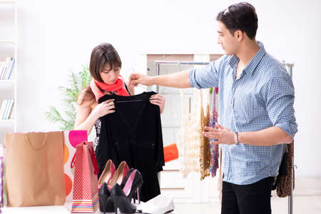 Shop assistant helping woman with buying choice Stock Photo
