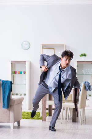 Businessman late for office due to oversleeping after overnight working Foto de archivo