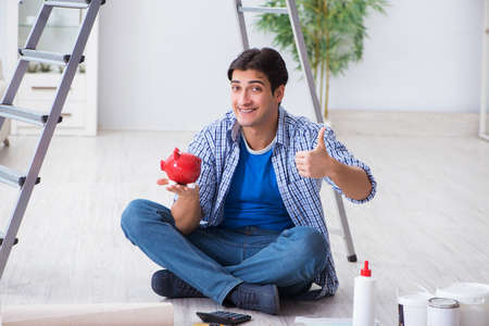 Young man overspending his budget in refurbishment project Stock Photo