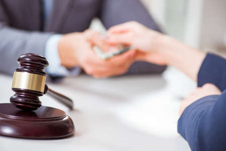 Lawyer being offered bribe for his services Stock Photo