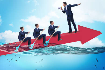 Teamwork concept with businessmen on boat Reklamní fotografie
