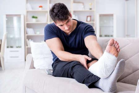Man with broken leg recovering at home Stock fotó
