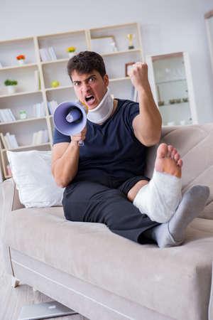 Man injured in car crash recovering at home from whiplash injury Stock Photo