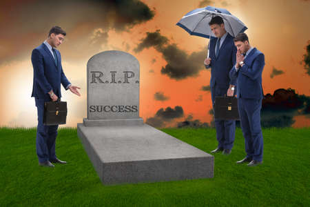 Businessman mourning the death of success Фото со стока