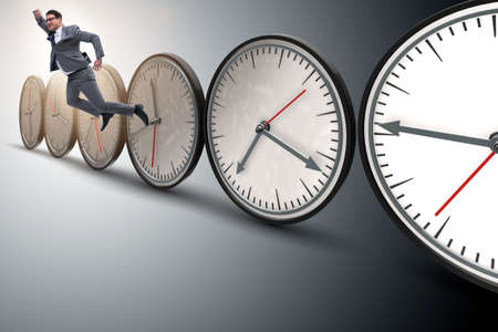 Businessman in time management concept Banco de Imagens