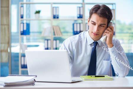 Businessman employee talking on the office phone Standard-Bild