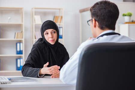 Muslim woman visiting doctor for regular check-up Reklamní fotografie