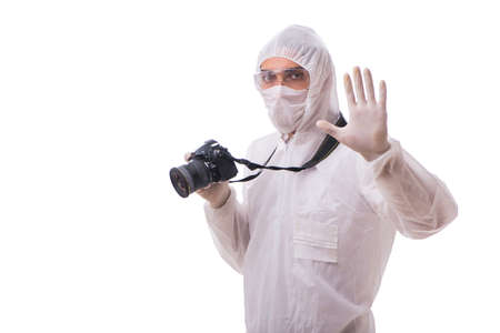 Forensic specialist in protective suit taking photos on white Foto de archivo