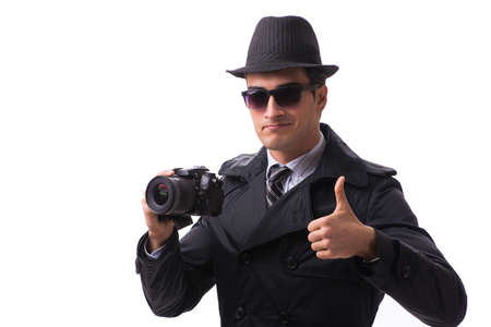 Spy with camera taking pictures isolated on white 写真素材
