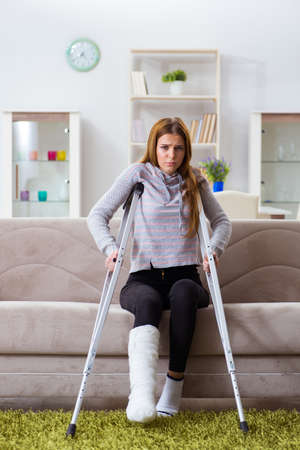 Young woman with broken leg at home