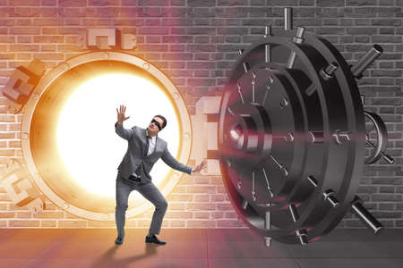 Businessman in front of banking vault door