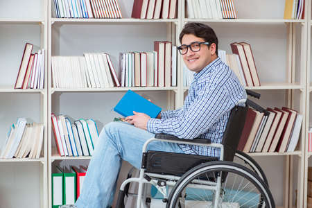 Disabled student studying in the library