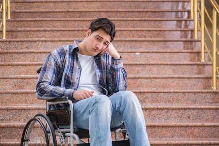Disabled man on wheelchair having trouble with stairs Stock Photo