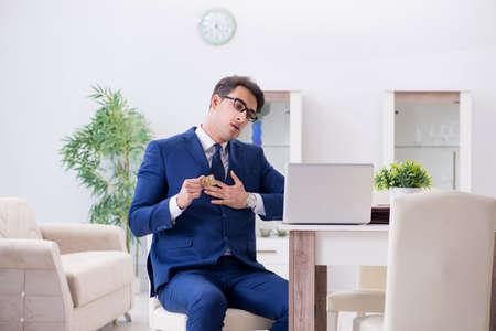 Bankrupt businessman having heart attack at home Standard-Bild - 100223423