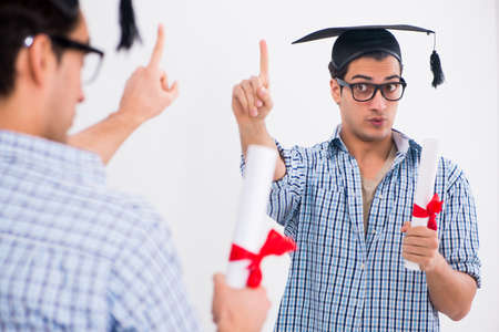 Young student planning graduation speech in front of mirror