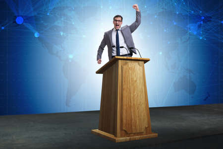 Man businessman making speech at rostrum in business concept Stock Photo