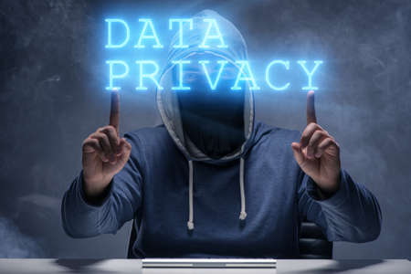 Data privacy concept with hacker stealing personal information 版權商用圖片