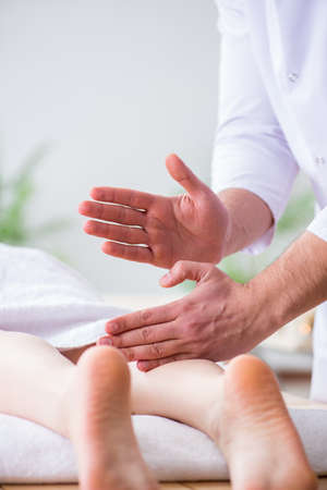 Foot massage in medical spa Stock Photo