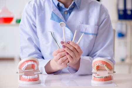 Dentist practicing work on tooth model Фото со стока