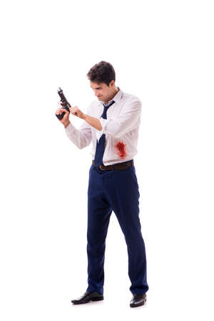 Businessman wounded in gun fight isolated on white background 免版税图像